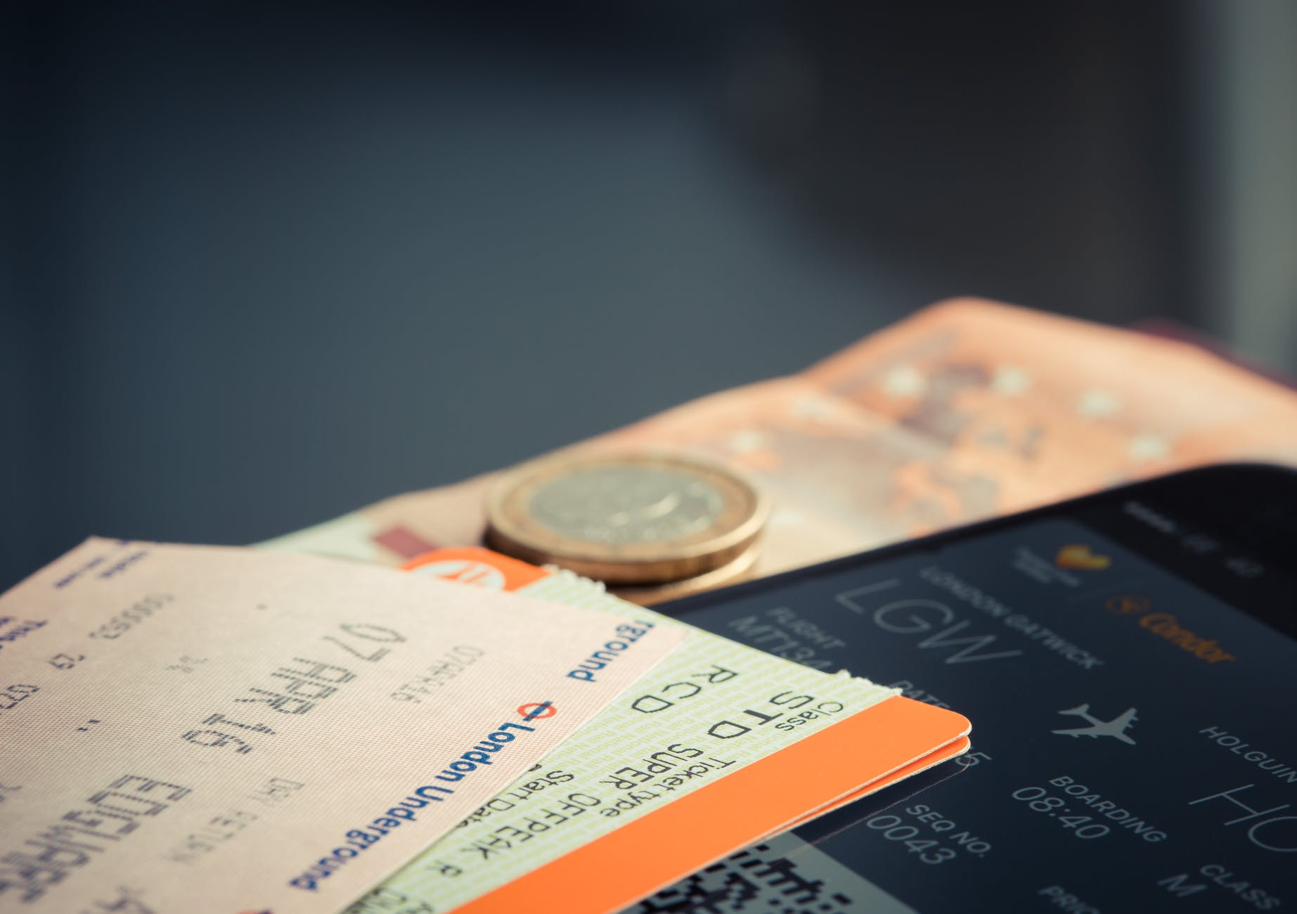 orange and green label airplane ticket